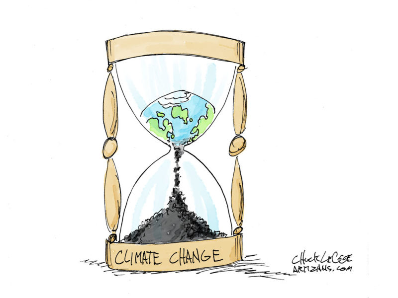 An hourglass labeled climate change with the Earth sifting through it.
